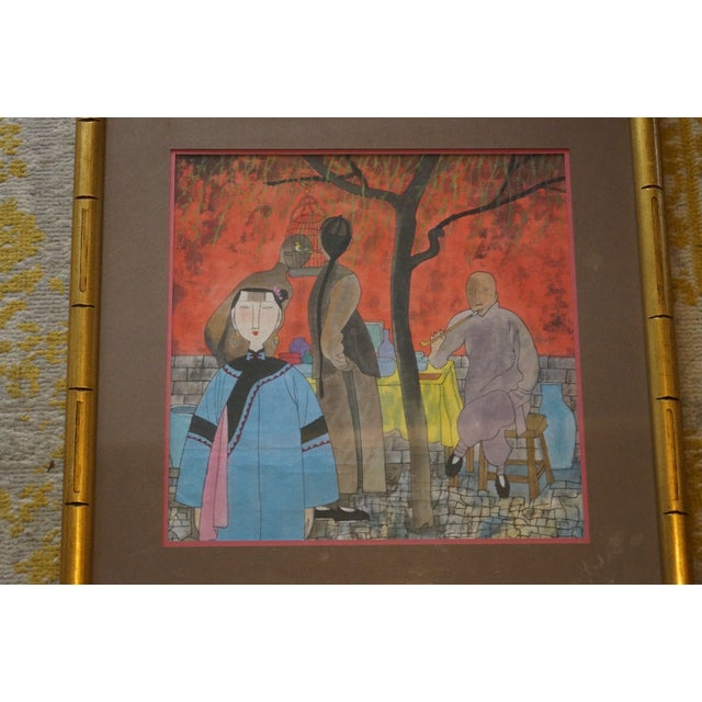 A beautiful piece of framed Chinese art depicting a colorful outdoor social scene with two women and a man who is smoking...