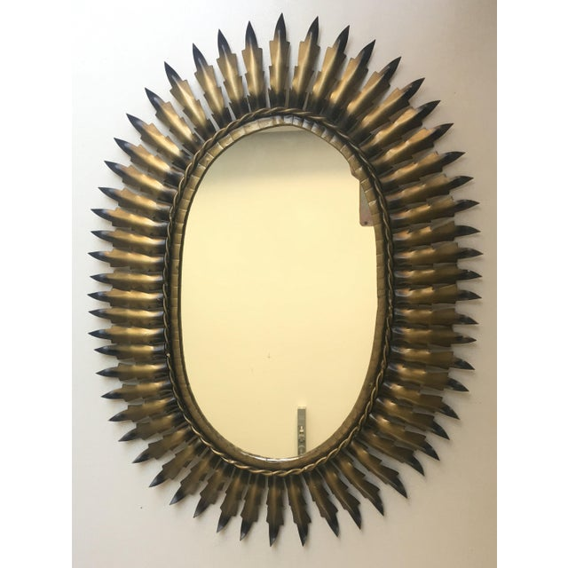 Spanish Gilt Metal Oval Sunburst Mirror Spanish 1950s gilt metal oval sunburst mirror with tight connected leaf pattern...