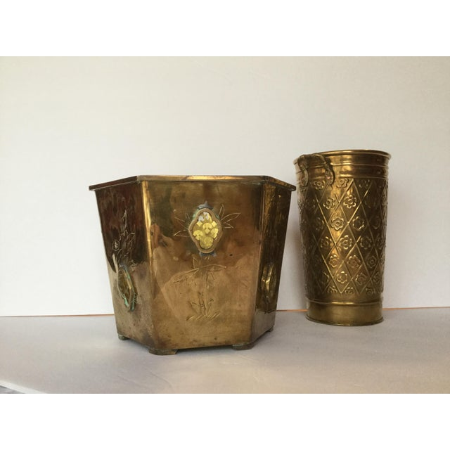 This pair of brass planters will show off the flowers or plants in your home. The six sided brass flower pot sits on six...