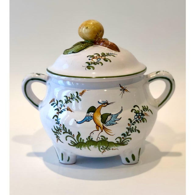 Charming Provencal earthenware serving pot with lid. Hand painted with a delicate blue bird, leafy floral bowers, and...