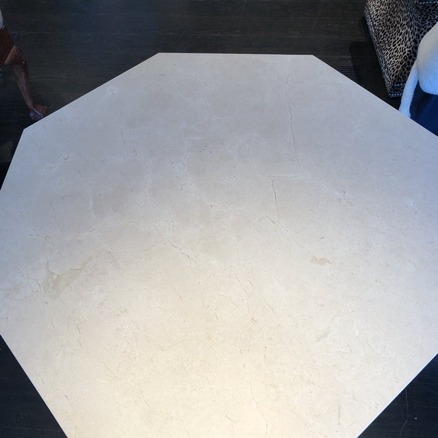 This beautiful table has a cool marble round resting on a pretty octagonal pedestal base of hand-applied reeded wood...