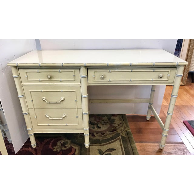 Vintage cream painted faux bamboo writing desk with light blue accent color. White laminate top. Comes with matching faux...