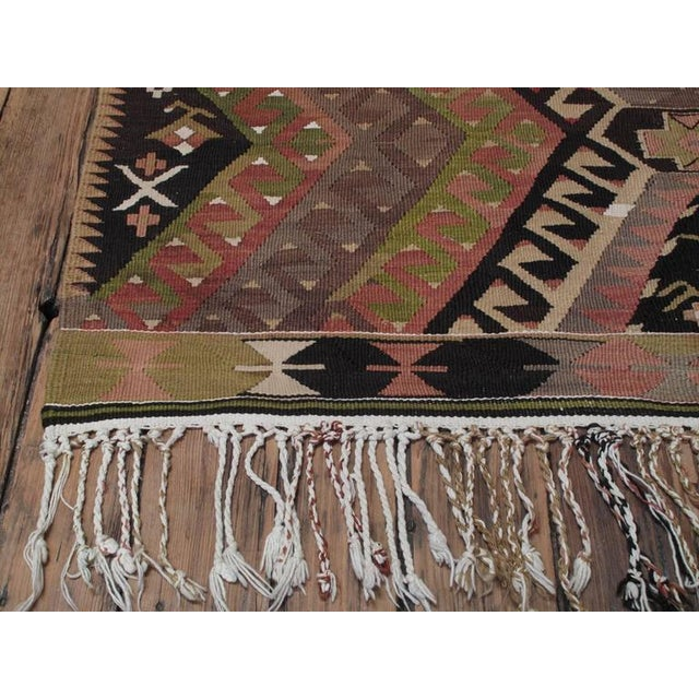 A beautiful old tribal Kilim from Southwestern Turkey in an unusual small and square-ish format with a charming rendition...