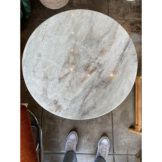 Gorgeous marble side table with circular top and square base. Perfect piece next to any seating arrangement.