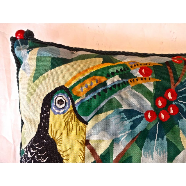 """A Toucan eating red berries needlepoint square pillow. French """"e au ver a soie & quot;e silk thread, trimmed in dark green..."""