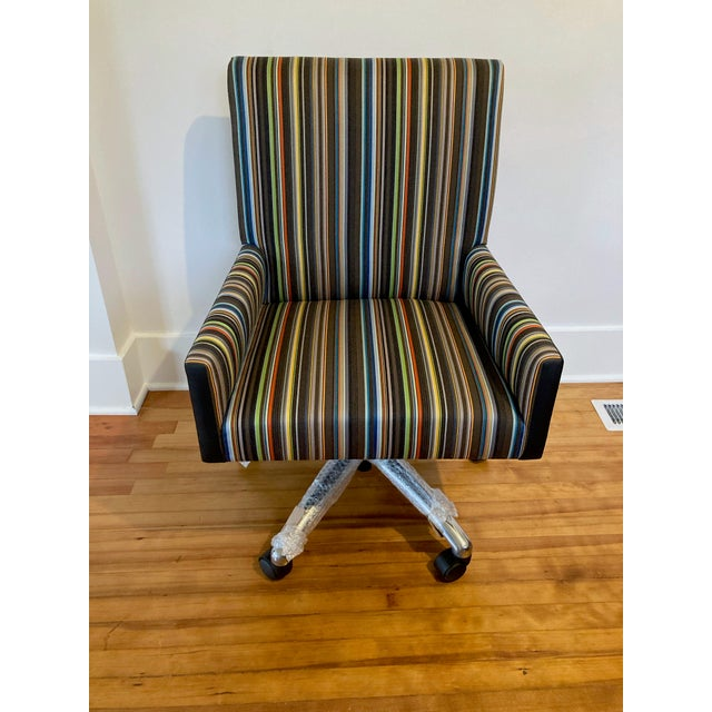 Brand new in box JL Furnishing adjustable upholstered rolling desk chair. Upholstered in textured black leather on the...
