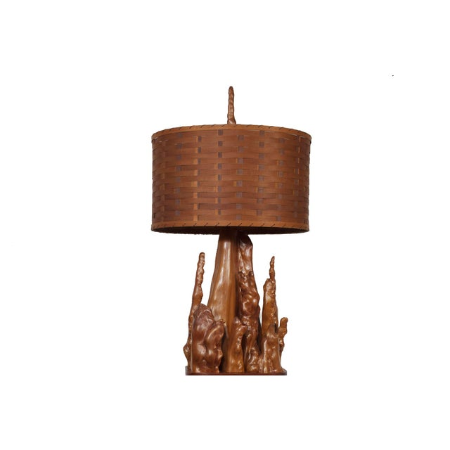 This large, exceptional and unusual cypress knee floor lamp with basket weave shade will make an exciting addition to any...