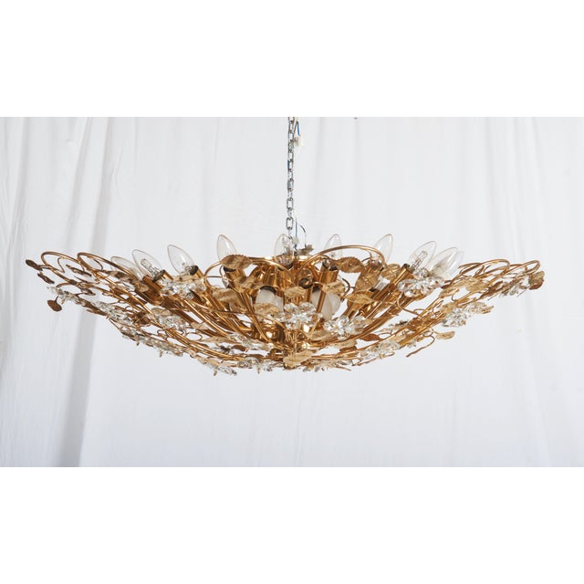 Brass frame gold-plated with cut crystal elements leaves and flowers decor. Fitted with 35(!) E14 sockets up to 60watts...