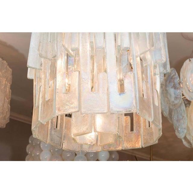 """Iridescent """"C"""" link glass chandelier."""