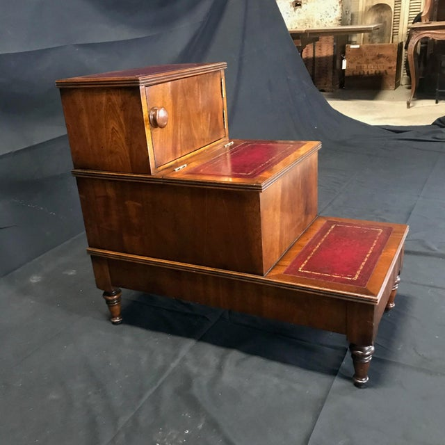 An unusually handsome set of mahogany library steps having a lovely burgundy tooled leather on the treads, ebonized inlaid...