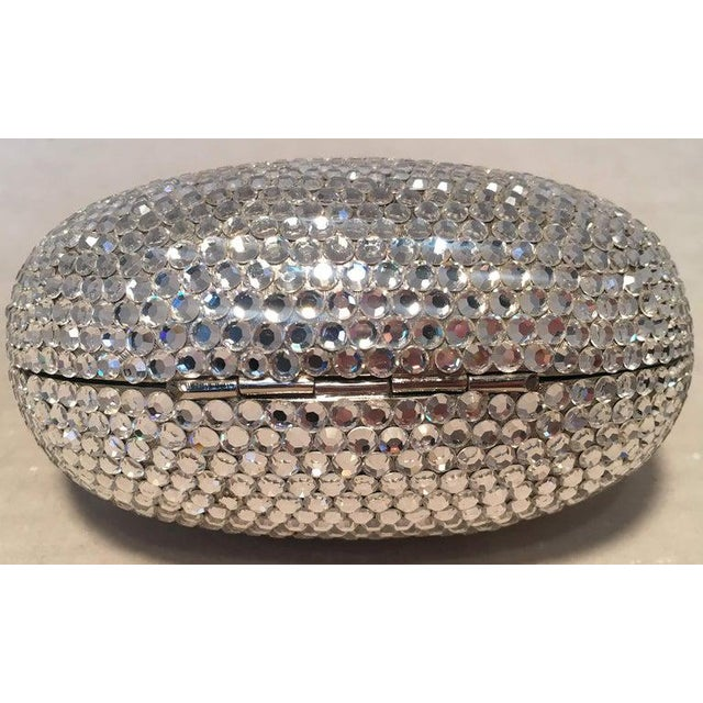 Judith Leiber Silver Metal and Swarovski Crystal Coin Pouch Minaudiere in excellent condition. Silver metal body in...