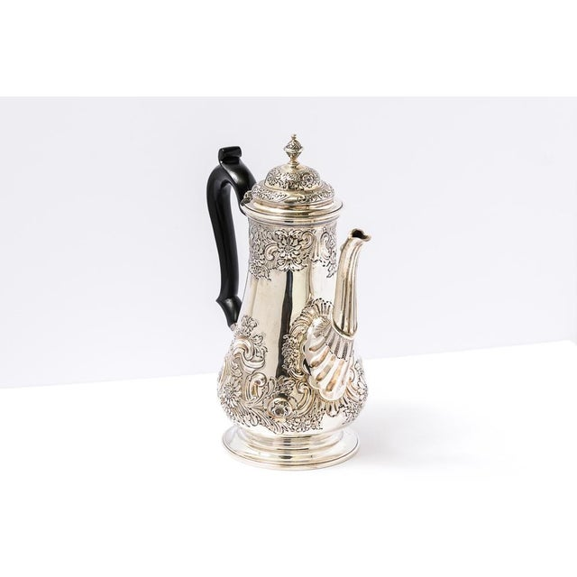 Beautiful, C.1899, English, Sheffield coffee pot with embossed design and black wood handle.