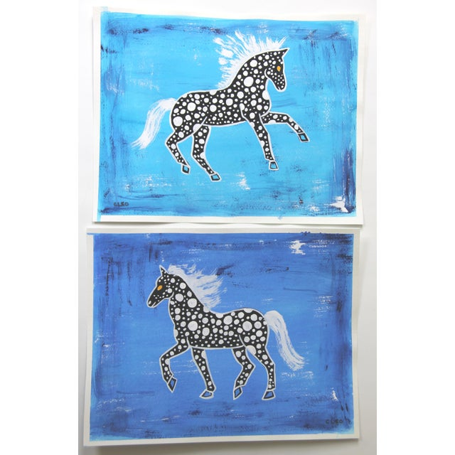 Inspired by playful horses in Chinese porcelain paintings, this black and white abstract spotted horse pair of paintings...