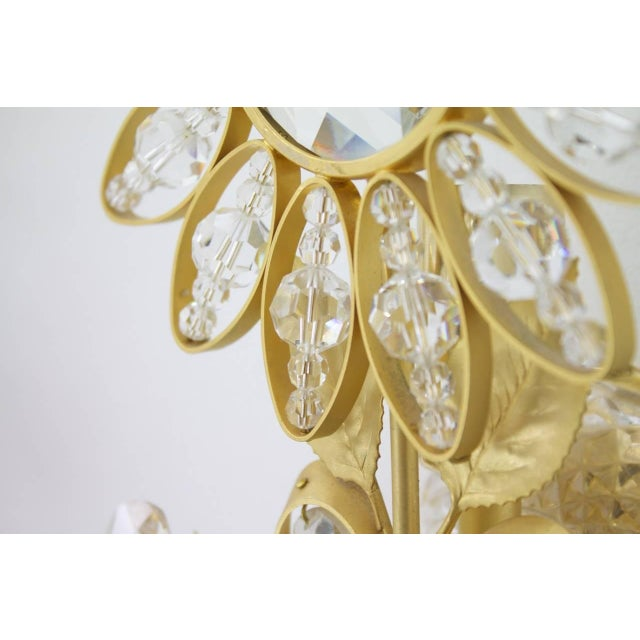 Beautiful high class wall sconces by Faustig, Germany, 1970s. Crystal glass and brass. Excellent condition.