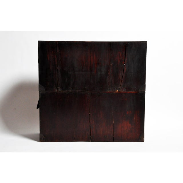 This two part Tansu chest is from Japan and was made from paulownia wood, circa 1900. The piece features seven drawers...