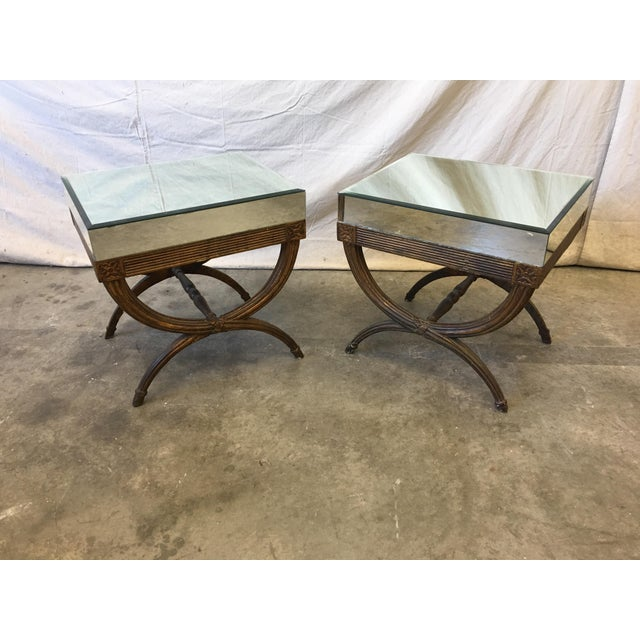 Stylish pair of Continental Directoire mirrored side tables. This pair features raised tops, fitted with beveled mirror,...