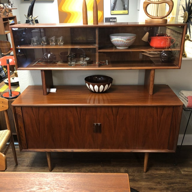 Beautiful old growth rosewood credenza with floating buffet top designed by Kofod Larsen for Faarup Mobelfabrik. Single...