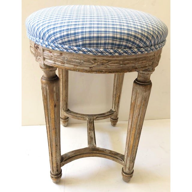 French gilt wood stool with blue and white upholstery and original paint.