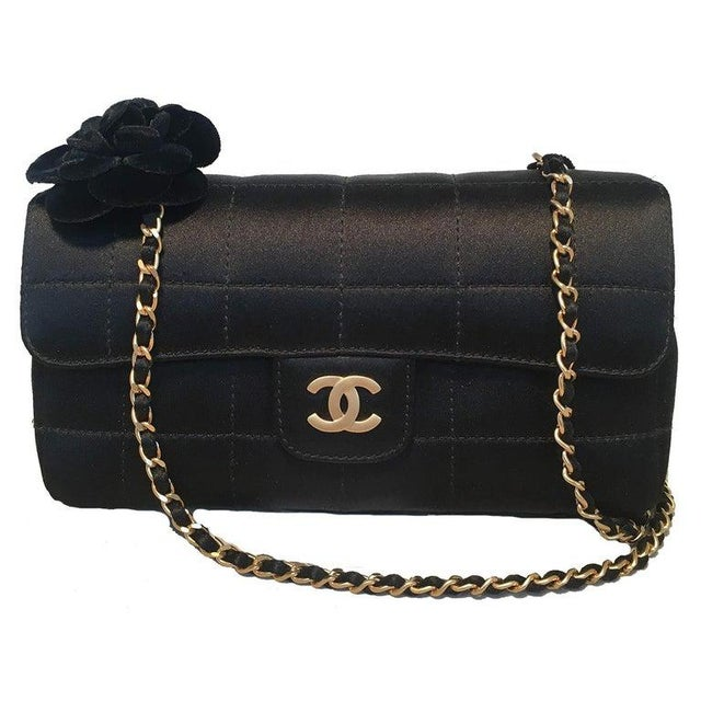 Chanel Quilted Black Silk Mini Camellia Classic Flap Shoulder Bag in excellent condition. Square quilted black silk...