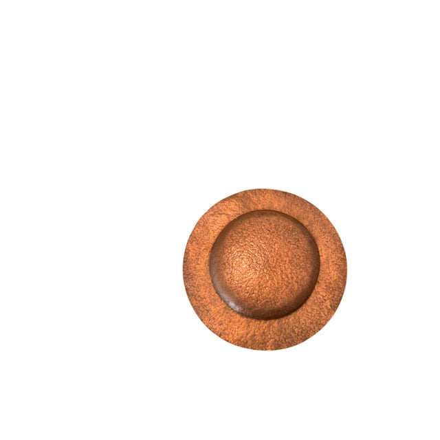 """This is a hand hammered copper charger. It is 14"""" in diameter and is 1/2"""" tall. There are no dents or scratches just a..."""