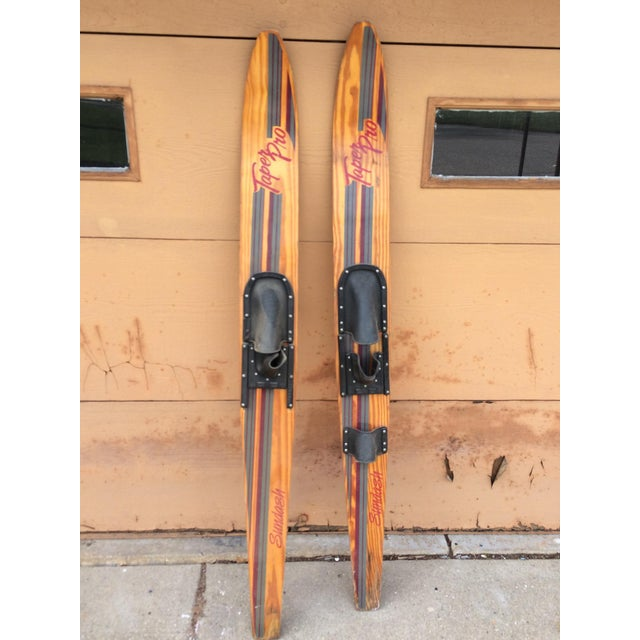Vintage wooden taper pro water skis. Perfect decoration for a lake or beach house.