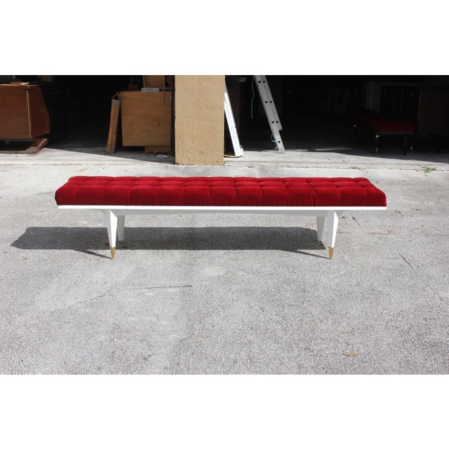 A long French Art Deco snow white lacquered Mahogany sitting bench, circa 1940s. Newly upholstered in a very high textile...