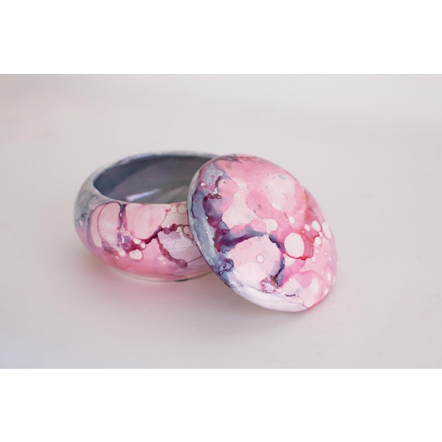 Stunning trinket box with removable lid, painted in a swirl of water color delight finished with metallic sheen. This...
