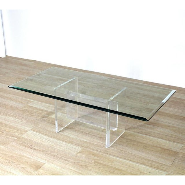 Nice shape 24 x 48 rectangle coffee table on solid Lucite base.