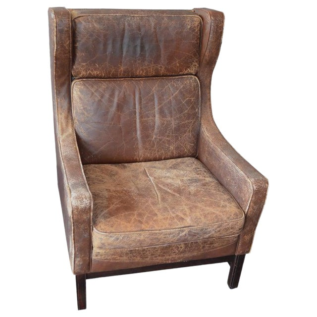 Club Chair of Worn Leather From Edwardian England, Wingback, Early 20th Century For Sale