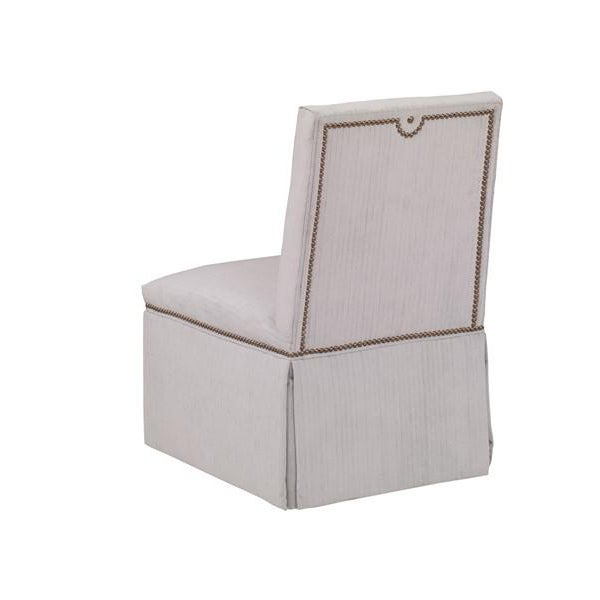 Slipper chairs, says Mary McDonald, are lovely and practical additions to most design plans. They often appear in her own...