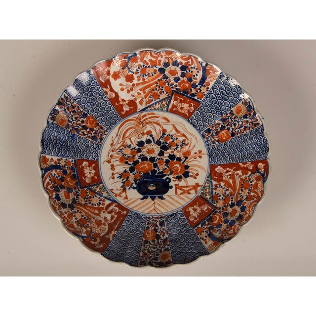 A large Imari platter with a scalloped rim imported from Japan c. 1885 into France. Please notice the traditional design...