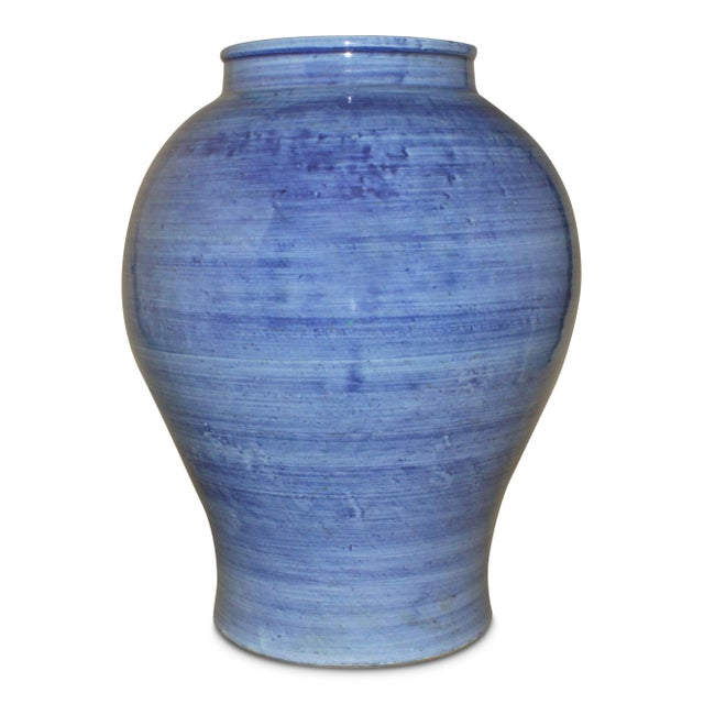 Material is ceramic hand painted blue grey.
