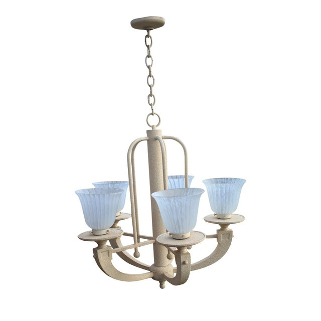 Vintage Chandelier designed by Fredrick Ramond in 89'. Neoclassic styled iron chandelier with faux stone texture....