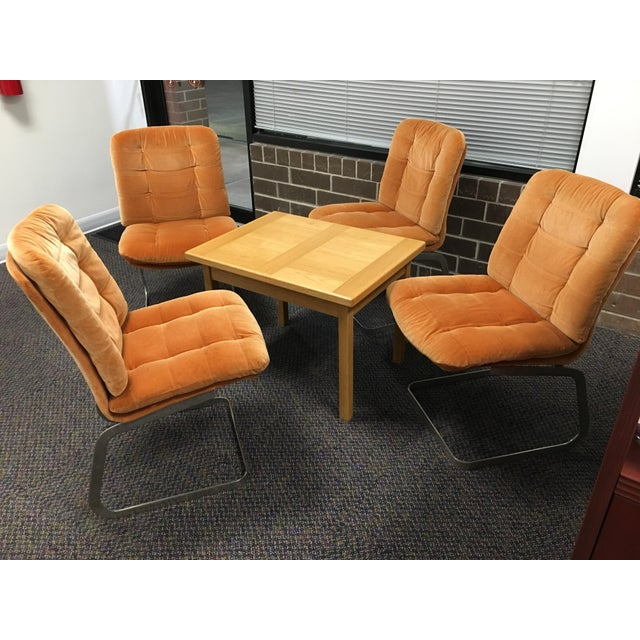 Here are four gorgeous Roche-Bobois dining chairs made by Furnitrad of Quebec in 1975 in their original burnt orange...