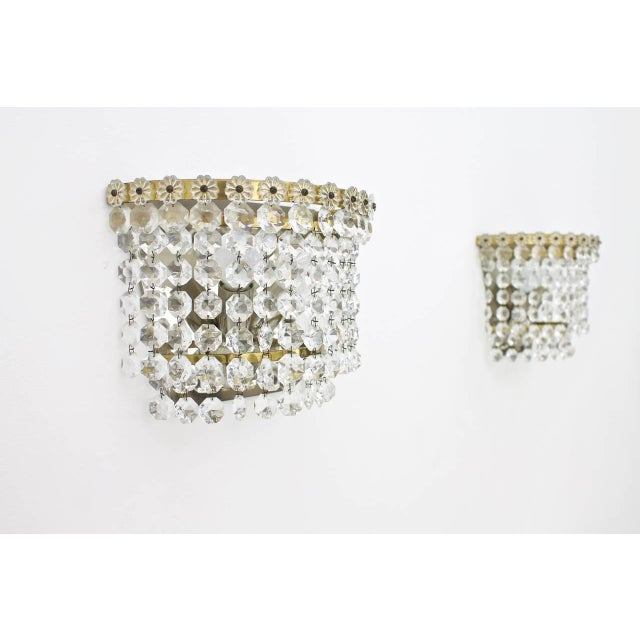 Set of our crystal glass, brass and metal wall sconces by Bakalowits, 1960s. Very good condition. Price is per item. Four...