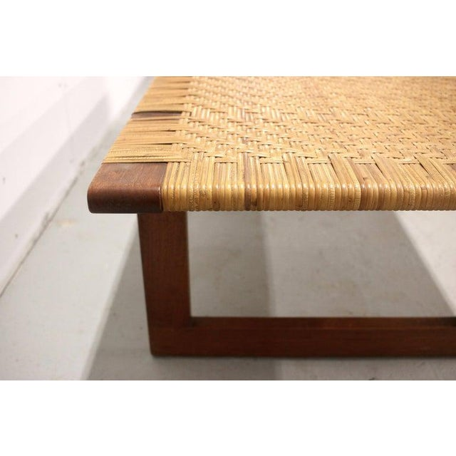 A wonderful rare teak and cane bench designed by Børge Mogensen for Erhard Rasmussen, Denmark, in the 1950s. Remenants of...