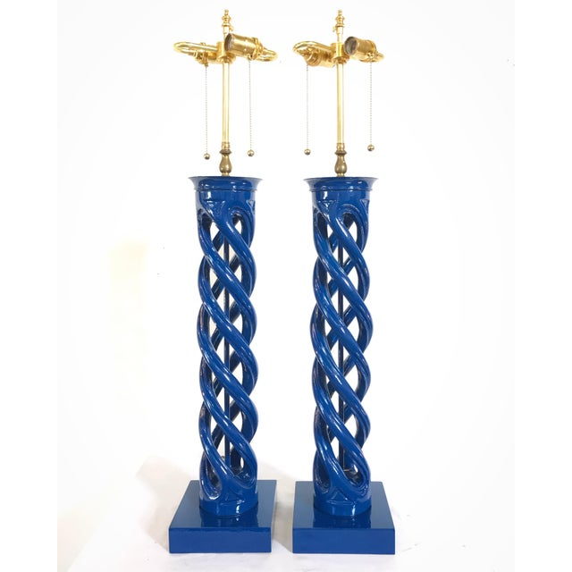 A pair of Mid Century tall sculptural double helix form lamps by Frederick Cooper . designed by the infamous James Mont....