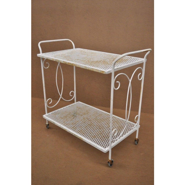 Item: Vintage Wrought Iron Metal Mesh Garden Bar Tea Cart Side Table Salterini Style Details: Iron construction, 2 metal...