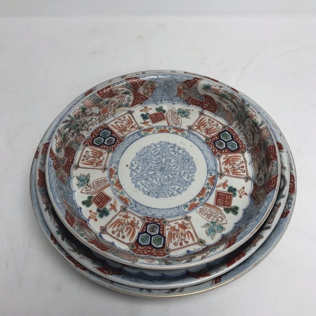 Great set of three Imari nesting bowls with lovely hints of turquoise, purple and green mixed in with traditional red and...