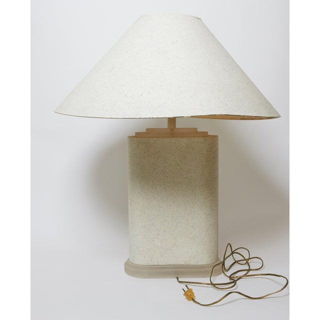 A show-stopping Frederick Cooper lamp. A Ceramic body, with classical style face in relief mounted on a stepped lucite...