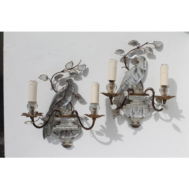 Stunning and rare pair of the authentic Maison Bagues Crystal Parrot Sconces. Bronze framed with crystal petal form. Ready...