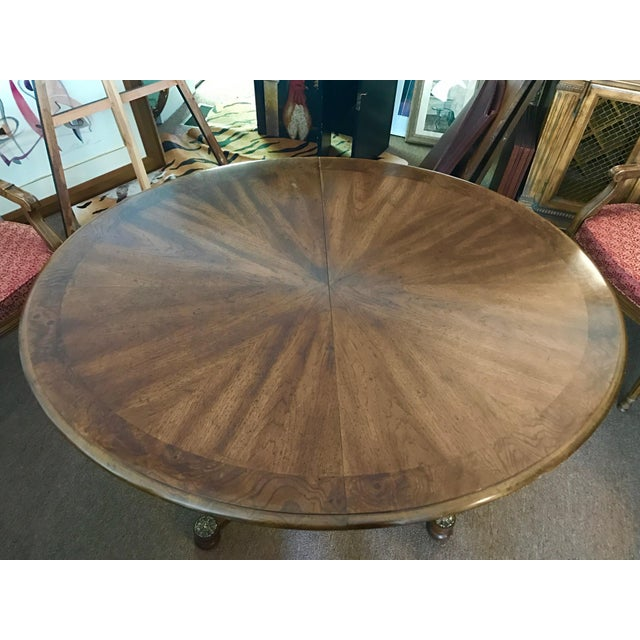 Henredon star burst dining table set and two leaves. Needs a little love - (hence, the great price)! Otherwise in...