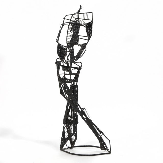 This terrific abstract sculpture of a figure conveys both a sense of motion and internal tension. With a an edgy linear...