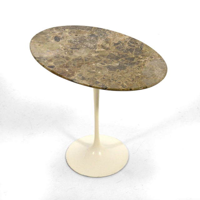 This rare early Saarinen Tulip side table by Knoll has an elliptical top of stunning stone which has a color and pattern...