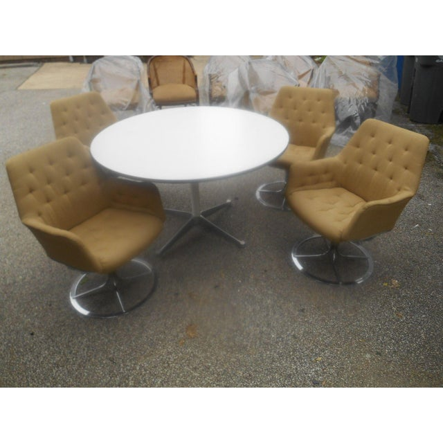 This is a set of 4 chrome and fabric swivel dining chairs in the Jetson Style marked DUX paired with a Herman Miller...
