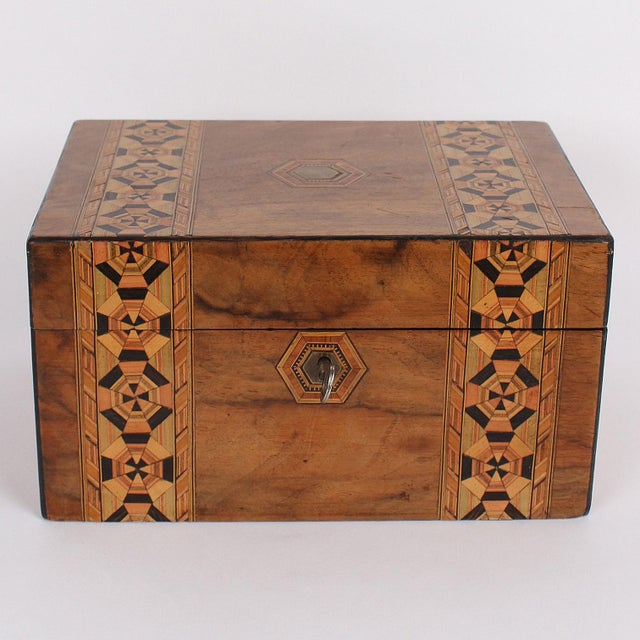 Gorgeous 19th century English box with two rows of intricate inlaid geometrical woodwork running crosswise across the top...
