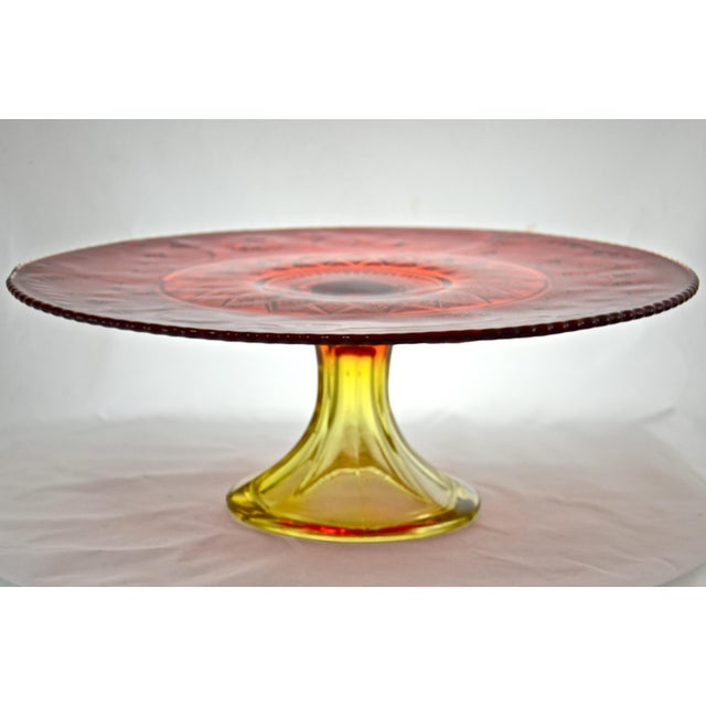 Large vintage 13.5 inch red to amber gradient (amberina) glass pedestal cake stand with a scroll, diamond, and floral...