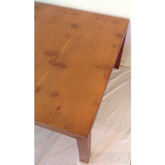 DUNBAR coffee table apple wood veneer. Dunbar metal label on underside of table. Made in the 60s. In excellent condition....