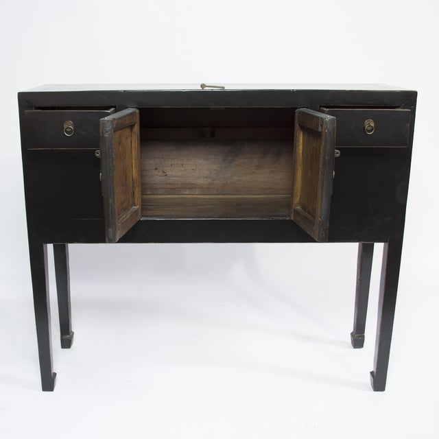Antique sideboard from the Chinese province of Shangdong. Made around the 1900s, this features 2 doors and 2 drawers with...