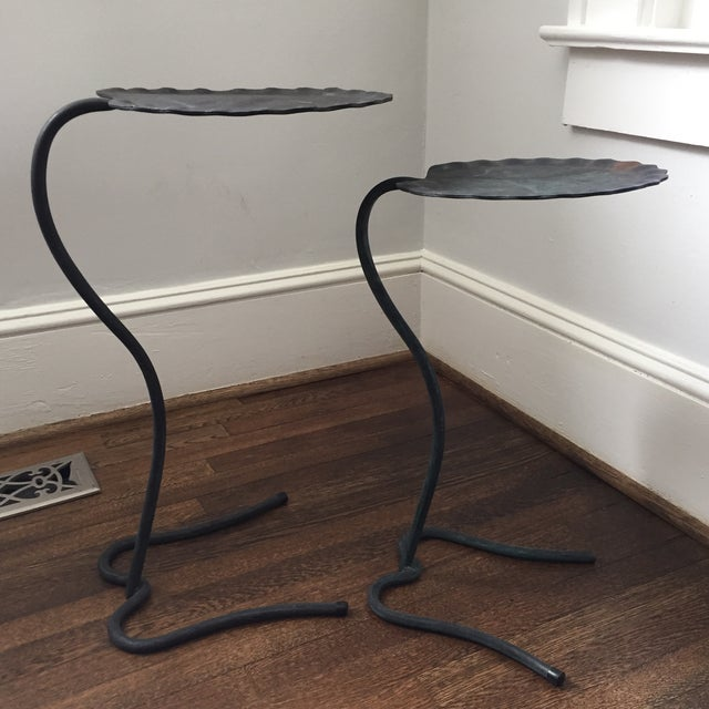 Pair of iconic Salterini lily pad nesting tables in a dark green finish. Each leaf shaped table top has a rippled edge.